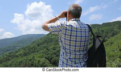 Tourist looking through binoculars