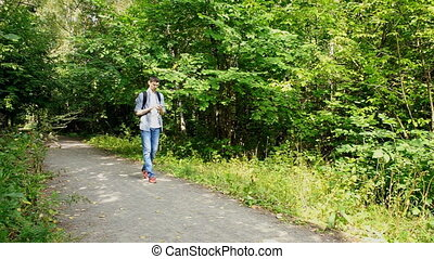 Tourist looks in phone where to go - Tourist looks in the...