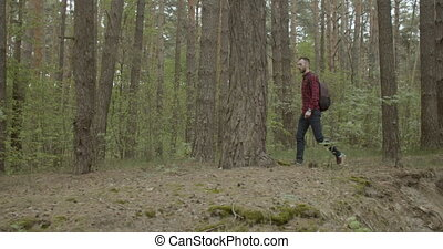 Tourist Man in the Forest - Young bearded man dressed in...