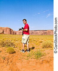 Tourist, man is taking pictures from beautiful sandstone...