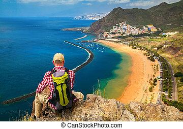 tourist man looking at the beach Playa de Las Teresitas