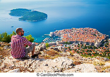 tourist man looking down to the Old Town of Dubrovnik