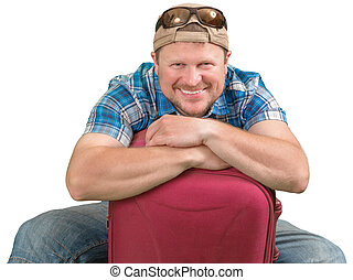 Tourist man sitting with suitcase on white background