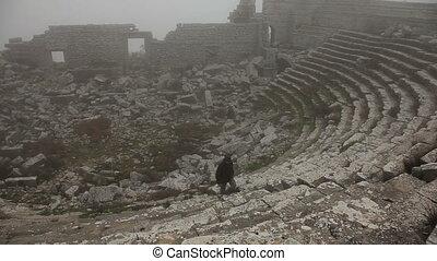 Tourist man visiting ancient  amphi