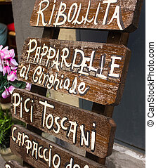typical Tuscan menu for tourists on the street exposed to attirere attention