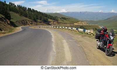Tourist Motorcycle Stands Along a Serpentine Road in the Mountains of Armenia. Moto travel.