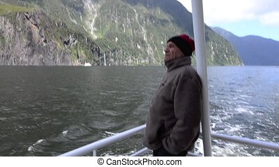 Tourist on a Cruise in Milford Sound, New Zealand - Mature...