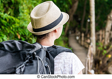 tourist on holiday with a large backpack backpack view back