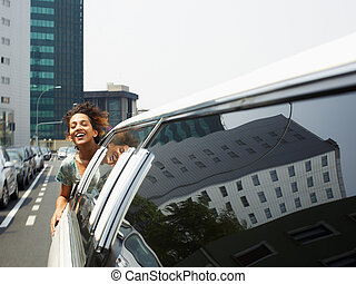 tourist on limousine - hispanic woman in limousine with head...
