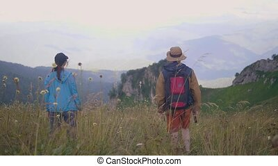 Tourist people looking on beautiful mountain landscape while summer travel