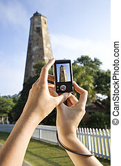 Tourist photo. - Close up of Caucasian woman\'s hands...