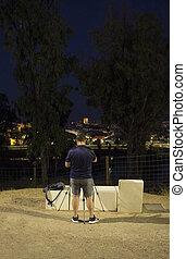 Tourist photographer taking picture to Badajoz old quarter, Spain
