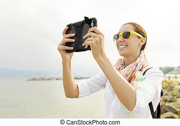 Tourist photographing at beach
