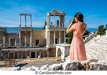 Tourist photographing Roman theater in Plovdiv - Young woman...