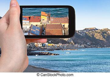tourist photographs houses in Giardini Naxos - travel...