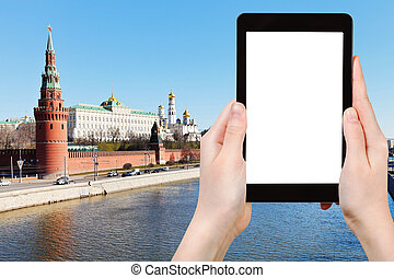 tourist photographs Moscow cityscape with Kremlin