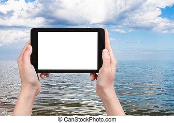 tourist photographs of Azov Sea on tablet pc - travel...
