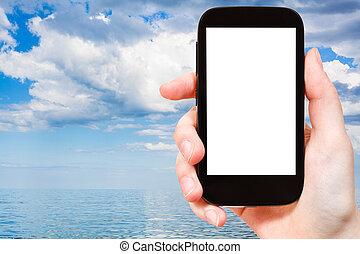 tourist photographs of blue water Azov Sea - travel concept...