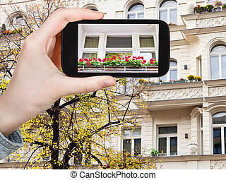 tourist photographs of facade of house in Berlin