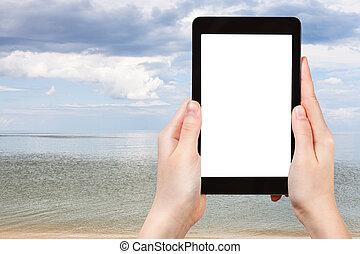 tourist photographs of view of Azov Sea - travel concept -...