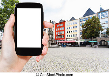 tourist photographs Old Market square in Cologne