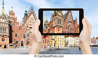 tourist photographs Old Town Hall in Wroclaw