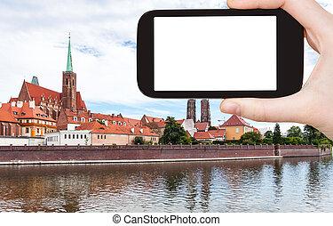 tourist photographs Ostrow Tumski in Wroclaw