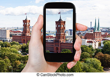 tourist photographs Red City Hall in Berlin city - travel...