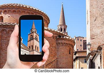 tourist photographs tower and Rotonda in Mantua - travel...