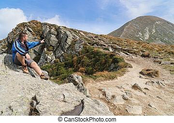 Tourist points to the mountain peak