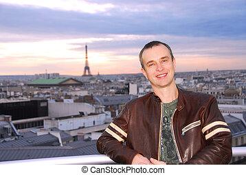 Tourist - Portrait of a man on background of Paris view