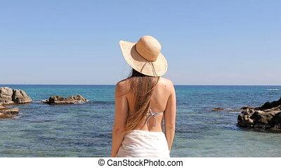 Tourist reaching the beach and breathing fresh air