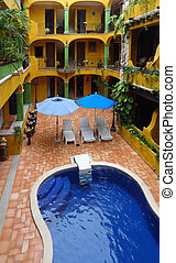 tourist resort with pool at Playa del Carmen in Mexico