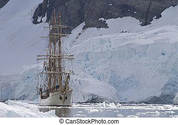 tourist sailing ship on a background of mountains and glaciers o