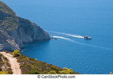 Tourist ship at the cliff coast of Zakynthos