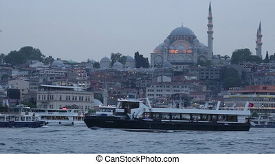 tourist ships in the passage the Gold Horn against the...