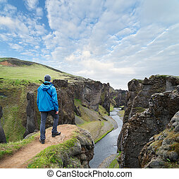 Tourist standing on the top of the canyon in Iceland