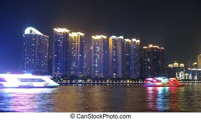 Tourist steamships swim on Pearl river at night against...