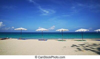 Tourist Sunbathing on Tropical Surin Beach, Phuket, Thailand...