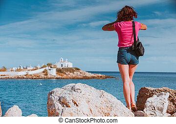 Tourist take photo from Agios Fokas Peloponnese Greece - ...