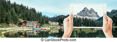 Tourist taking a picture of the Dolomites - Tourist ...