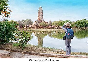 Tourist taking photo at the ancient city Ayutaya ,Thailand