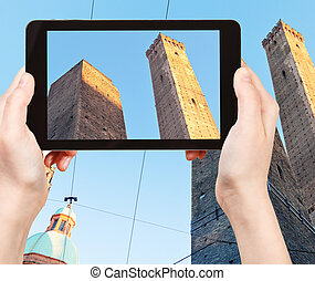tourist taking photo Due Torri in Bologna