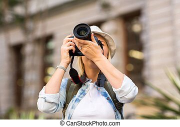 tourist taking photo in city - tourist taking photo in the...