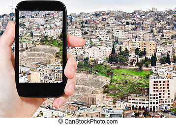 tourist taking photo of Amman city, Jordan