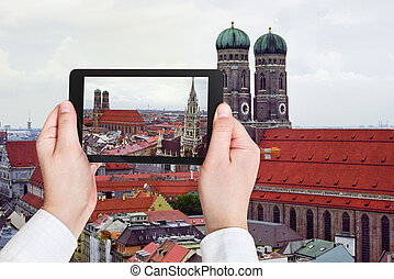 tourist taking photo of Frauenkirche in Munich