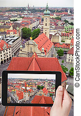 tourist taking photo of Munich skyline