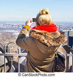 Tourist taking photo of New York City.