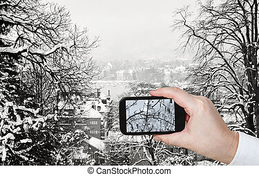 tourist taking photo of Zurich skyline in winter