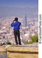 tourist taking photos in Barcelona city, Spain